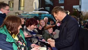 Liam Neeson signs autographs for fans as he arrives for the 2016 Irish Film and Drama awards at the Mansion House in Dublin. Photograph: Michael Chester/PA