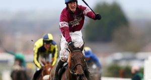 David Mullins celebrates after winning the Crabbie's Grand National steeplechase on Rule The World at Aintree. Photograph: Michael Steele/Getty