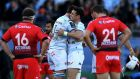 Bernard Le Roux and Dan Carter embrace after Racing 92's win over Toulon. Photograph: AFP