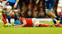 Justin Tipuric of Wales after suffering his concussion injury against Italy. Photograph: Donall Farmer/Inpho