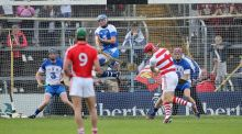 Waterford goalkeeper Stephen O'Keeffe bravely stops Anthony Nash's penalty in the 2014 Munster championship quarter-final replay. Photograph: Cathal Noonan/Inpho.