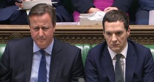 "British prime minister David Cameron and his finance minister George Osborne in the houses of parliament in London on Monday: he told MPs it was ""natural human instinct"" for parents to help their children. Photograph: AFP/Getty Images"