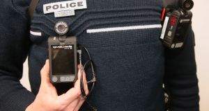 A French police officer wearing a body-worn camera. File photograph: Jacques Demarthon/AFP/Getty Images
