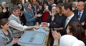 Syrian president Bashar al-Assad and wife Asma after casting their votes in Damascus, Syria: Voting was extended until midnight, but is unlikely to produce any surprises in the 250-seat assembly or challenge the dominance of the Baath party. Photograph: Sana/Reuters