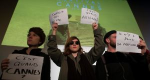 "Entertainment industry workers stage a protest against labour reforms before the official presentation of the film selection in competition at the upcoming 69th Cannes Film Festival, during a press conference in Paris, France, April 14th, 2016. Signs , from left, read: ""When is Cannes?"", ""Deficit Yourself"", ""When is Avignon [festival]?"" and ""There is no more festival"". Photograph: Ian Langsdon/EPA"