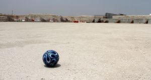 A football is seen at the construction site of Al Wakrah stadium in Qatar. Photograph: Naseem Zeitoon/Reuters