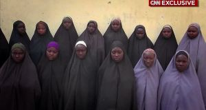 "Screen grab from a video the Nigerian government has said is  ""proof of life"" of 15 of the more than 200 schoolgirls abducted by Boko Haram. Photograph: AFP/CNN"