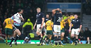 Craig Joubert sprints from the pitch at the end of Scotland's narrow Rugby World Cup loss to Australia. Photograph: Getty