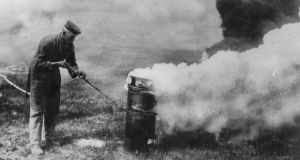 Deadly breeze: a German soldier releases chlorine gas into the wind during the first World War. Photograph: Henry Guttmann/Getty