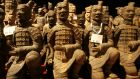 Scale-models of terracotta warriors are pictured on sale at the exhibition Power in Death - The Terracotta Army of the First Emperor of China at the Museum of Ethnology in Hamburg. Photograph: Reuters