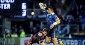 Leinster's Ben Te'o offloads as he is tackled by Edinburgh's Tom Brown during the Guinness Pro 12 game at the RDS. Photograph: Morgan Treacy/Inpho