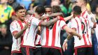 Sunderland celebrate Jermain Defoe's second half strike in their 3-0 win over Norwich City at Carrow Road. Photograph: PA