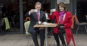 Acting Taoiseach Enda Kenny and Tánaiste Joan Burton at Herb Street Cafe, Grand Canal, Dublin, ahead of the election. File photograph: Brenda Fitzsimons/The Irish Times