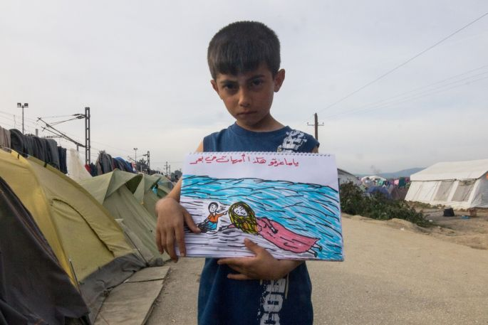 """The writing says """"many mothers drown in the sea"""".  Some 12000 refugees are now stranded at Idomeni camp, due to closed borders by the Macedonian authorities."""