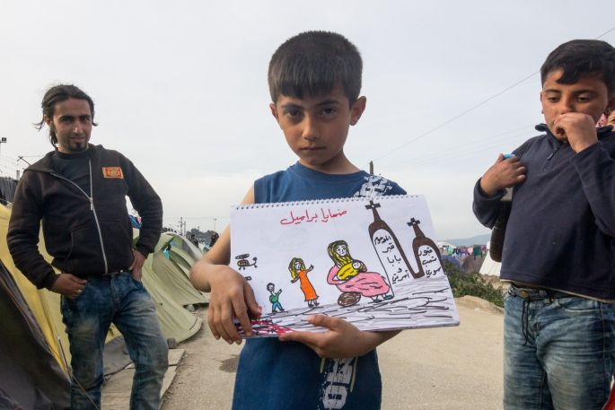 """The writing says """"war victims"""" and the writing on the graves refer to Syrian families."""