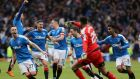Rangers players celebrate their penalty shootout win over Celtic at Hampden Park. Photograph: Reuters