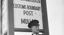 September 1961: A member of the Royal Ulster Constabulary (RUC) stands guard at a customs boundary post in Northern Ireland. (Photo by Keystone Features/Getty Images)