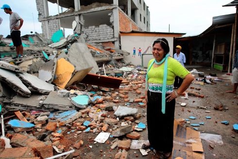 QUAKE AFTERMATH: In tears among the debris of a collapsed building after a 7.8 magnitude earthquake hit Ecuador. Photograph: EPA