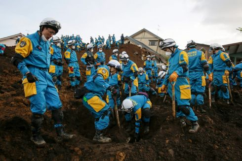 GRIM SEARCH: Rescue workers look for missing people at a massive landslide caused by a magnitude 7.3 strong earthquake on April 16th, in southwestern Japan. Photograph: Kimimasa Mayama/EPA