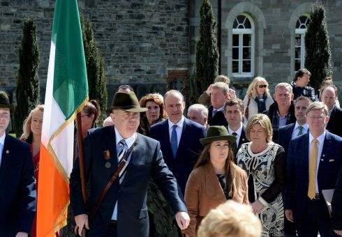 COLOUR PARTY: Flag bearer Anthony Greene leads the  way for Fianna Fail leader Micheal Martin and party members during the Easter Rising 1916 Commemoration at Arbour Hill. Photograph: Cyril Byrne/The Irish Times