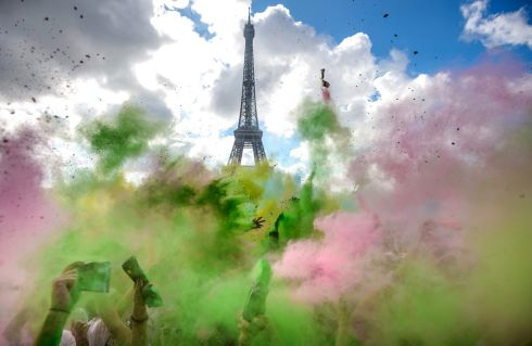 CHALK IT UP: People covered in colourful powder dance at the finish line after taking part in the Parisian Colour Run. The initiative takes place in cities worldwide. Photograph: Christophe Petit Tesson/EPA