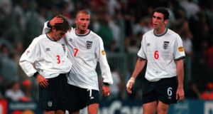 Phil Neville is consoled by David Beckham after giving away a crucial penalty against Romania at Euro 2000. Photograph: Getty