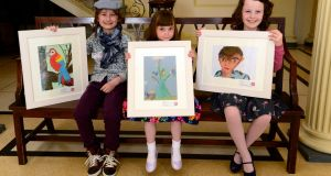 From left, Deaghlan McGovern from Dundalk,   Elle Giblin of Glasnevin and Eimear Donovan from Caherconlish, Co Limerick, winners  in the Texaco Children's Art Competition 2016. Photograph: Cyril Byrne/The Irish Times