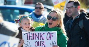 Charlotte Cargin with her daughter Eliza protest outside a Bord Pleanála oral hearing for an incinerator by Indaver. Photograph: Michael Mac Sweeney/Provision