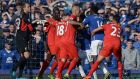 Liverpool and Everton players clash during the last Merseyside derby in October at Goodison Park, which ended in 1-1 draw. Photograph: Oli Scarff/AFP photo