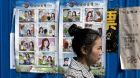 A woman walks by China's anti-espionage 'Dangerous Love' poster campaign. Photograph: Ng Han Guan/AP