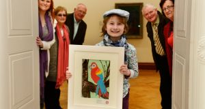 Deaghlan McGovern, from Dundalk, with his entry to the Texaco Children's Art Competition, which  was awarded second prize in his category. He is photographed at the Hugh Lane Gallery in Dublin with his mother Sheona McGovern (left), his aunt and uncle Bernadette and Seamus Ward and grandparents Tom and Pauline McGovern grandparents.  (right) in  the Texaco Childrens Art Competition at the Hugh Lane  Gallery yesterday. Photograph: Cyril Byrne/The Irish Times