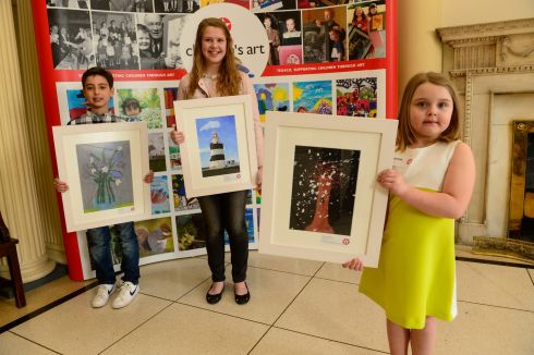 Winners in the Texaco Children's Art Competition: from left, Ryan Bouakkaz (7 - left), from Santry, Tara Watson, Dun Laoghaire, and Bonnie Sheppard (6)  from Belfast. Photograph: Cyril Byrne/The Irish Times