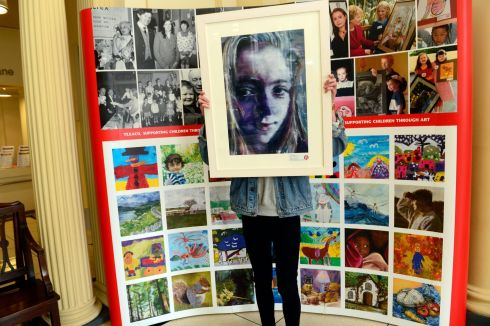 Harry Mathers, from Ballyclare, Co Antrim, holding his second prize winning  picture in the  Texaco  Children's Art Competition. Photograph: Cyril Byrne/The Irish Times