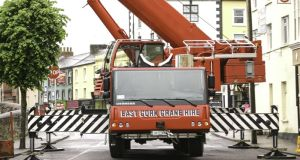 The owner of East Cork Crane Hire was  told that if he didn't remove all of his equipment it would be burned to the ground