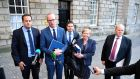 Fine Gael TD's Leo Varadkar, Simon Coveney, Paschal Donohoe, Frances Fitzgerald and Michael Noonan speaking to journalists after leaving talks on the formation of a government between Fine Gael and Fianna Fáil. Photograph: Aidan Crawley