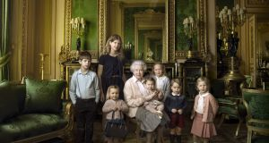 In this handout official photograph provided by Buckingham Palace to mark her 90th birthday, shows Queen Elizabeth II with her five great-grandchildren and her two youngest grandchildren. The children are: James, Viscount Severn (left), 8, and Lady Louise (second left), 12, the children of The Earl and Countess of Wessex; Mia Tindall (holding The Queen's handbag), the two year-old-daughter of Zara and Mike Tindall; Savannah (third right), 5, and Isla Phillips (right), 3, daughters of The Queen's eldest grandson Peter Phillips and his wife Autumn; Prince George (second right), 2, and in The Queen's arms and in the tradition of Royal portraiture, the youngest great-grandchild, Princess Charlotte (11 months), children of The Duke and Duchess of Cambridge. Photograph Annie Leibovitz via Getty Images