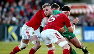 Finlay Bealham is tackled by Munster duo Billy Holland and Donnacha Ryan –  the Connacht man's  technique around the breakdown was magnificent.  Photograph: James Crombie/Inpho