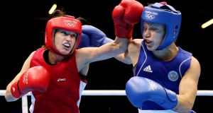 Katie Taylor fighting with Russia's Sofya Ochigava during the women's lightweight final at the London 2012 Olympic Games. Photograph: Scott Heavey/Getty Images.