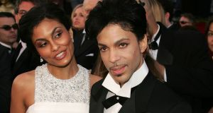Prince with Manuela Testolini at the  Academy Awards in 2005. Photograph: Carlo Allegri/Getty Images
