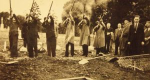 A soldier's life: a volley is fired over Edwward Keegan's grave at his funeral, in 1938. Photograph: family collection