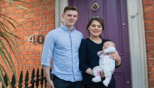 Claire Woods, her partner, Peter, and their baby girl, Alexandra, outside their Dublin home. Photograph: Brenda Fitzsimons