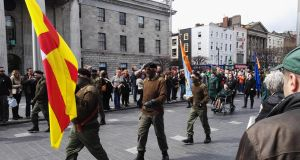 A paramilitary colour party marches down O'Connell Street as part of the Republican Sinn Féin 1916 parade, opposite the GPO, April 23rd, 2016.