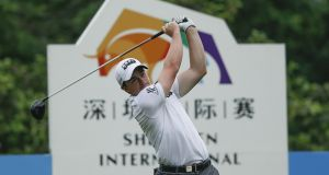 Paul Dunne of Ireland plays a shot during the third round of the Shenzhen International at Genzon Golf Club. Photograph: Lintao Zhang/Getty Images