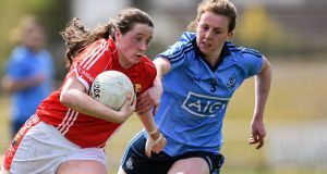 Cork's Aine O'Sullivan is tackled by Muireann Ni Scannaill of Dublin at St Brendan's Park, Birr. Photograph: Sportsfile