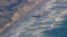 Solar plane lands after completing historic flight