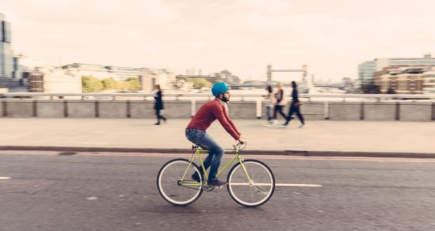 Cycling: the most pleasant and almost the cheapest way of getting to work in London. Photograph: Getty Images/iStockphoto