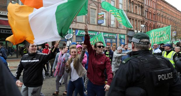 Loyalists protest in belfast as republicans mark easter rising young republicans march through belfast city centre on april 24th 2016 to commemorate the negle Image collections