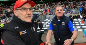 Tyrone's Mickey Harte and Cavan manager Terry Hyland shake hands after the game. Photograph: Lorraine O'Sullivan/Inpho