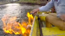 Australian politician blames fracking as he sets river ablaze