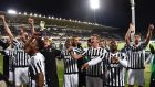 Juventus celebrate their win over Fiorentina, a result which effectively sealed the league title. Photograph: Epa